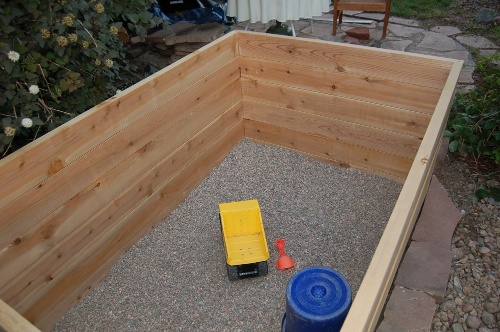 Sandbox with pea gravel