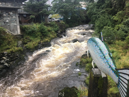 Ketchikan Creek with iridescent mosaic sculpture of a salmon.