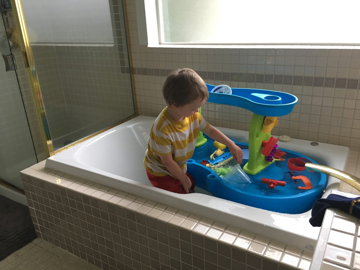 Julian in master bath with his large water table.