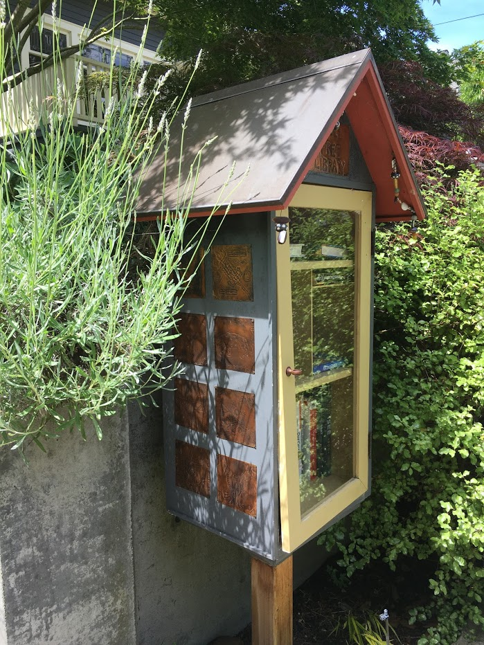 Little Free Library with copper plate decoration.