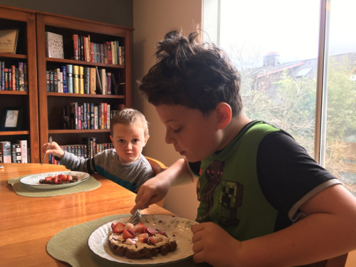 Calvin and Julian eating chocolate waffles.