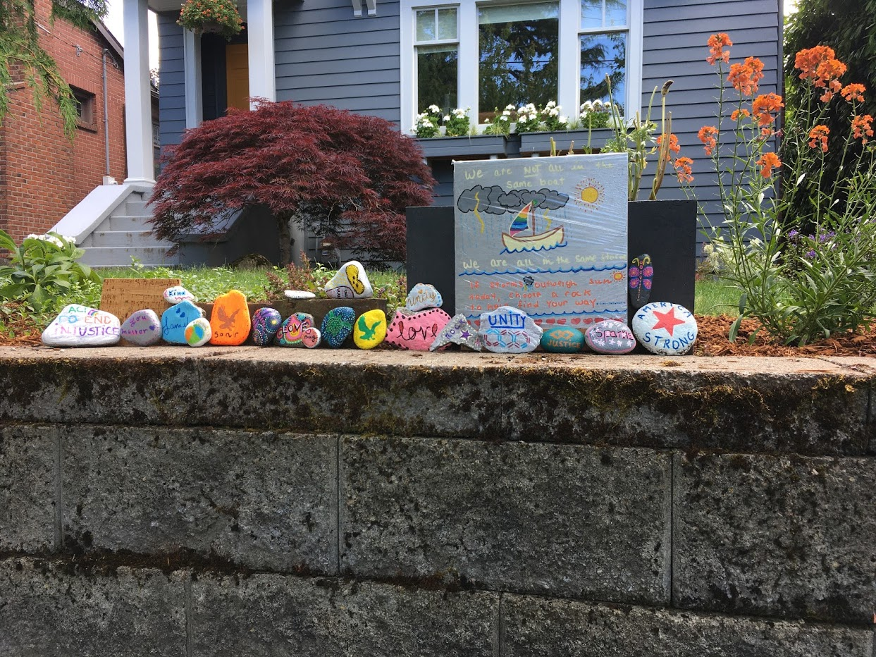 Rocks with inspirational sayings painted on them.