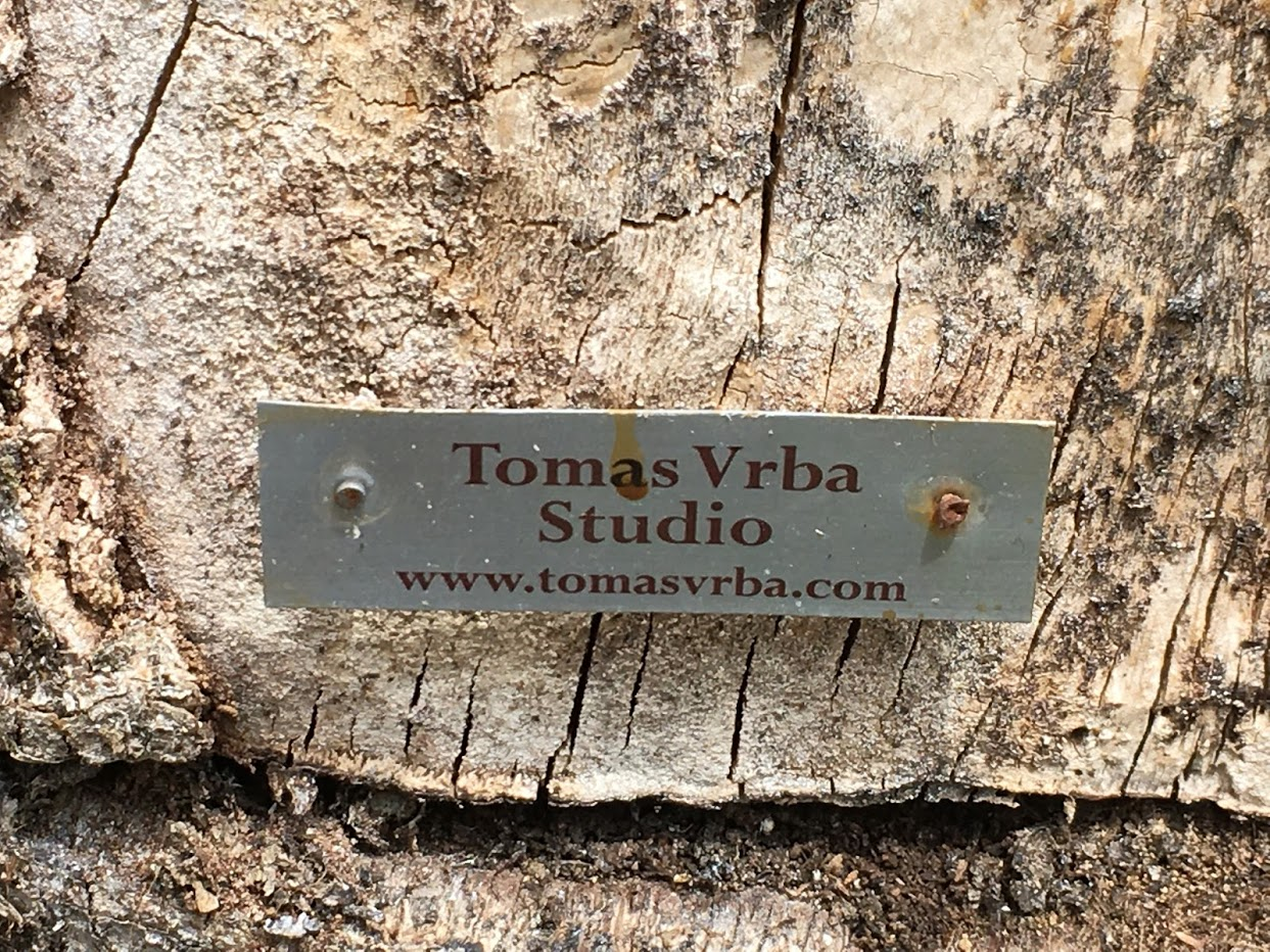 Thomas Vbra studio sign on tree trunk: www.tomasvrba.com