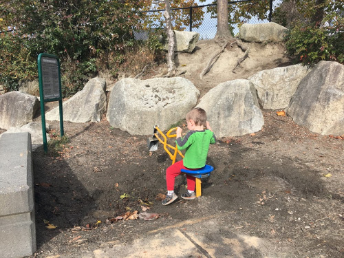 Julian using the digger to dig mud.
