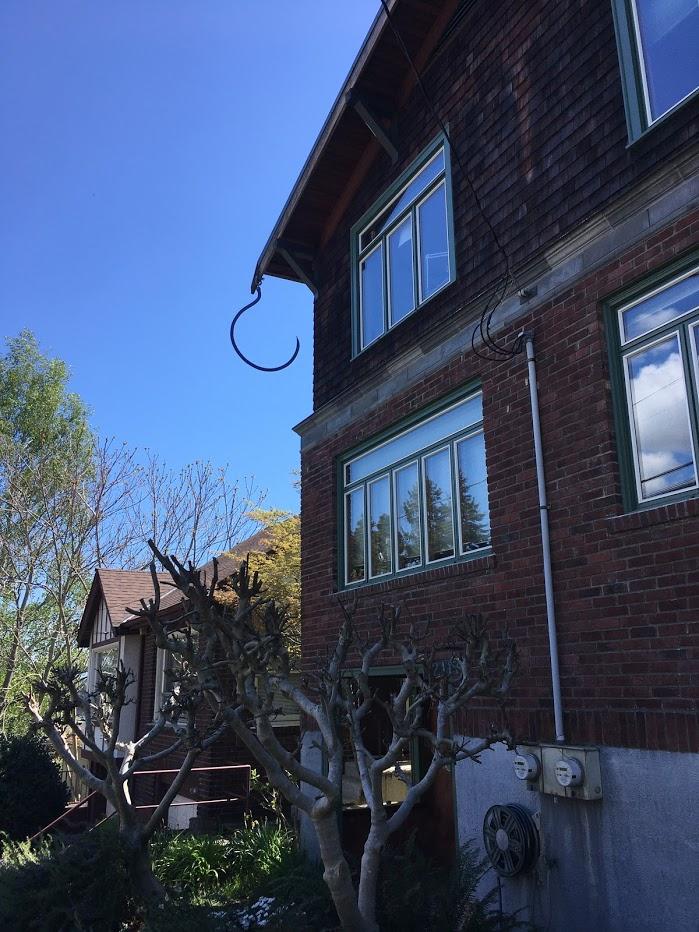 Random large hook hanging off the house.