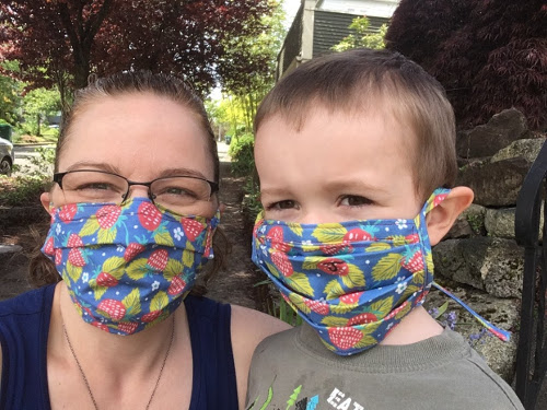 Julian and I posing with matching masks with a strawberry pattern.