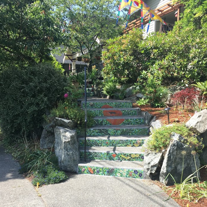 California poppy mosaic on steps going up to a house.