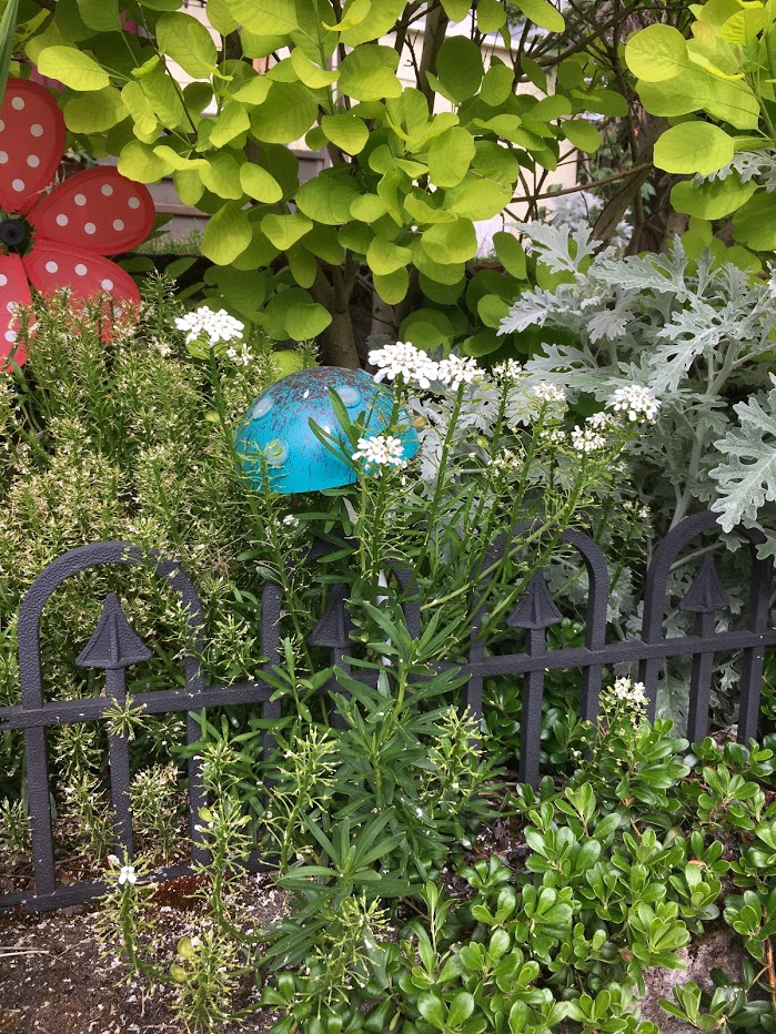 Yard picture: Ceramic blue mushroom cap.