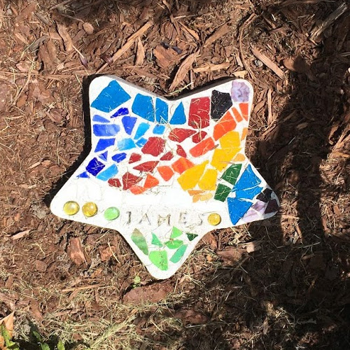 Colorful mosaic star with the word James on it.